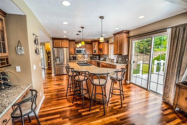 Kitchen with Hardwood Flooring and Quartz