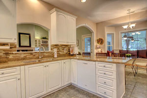 Kitchen with White Cabinets and Bay Window