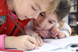 Kids Drawing in Book
