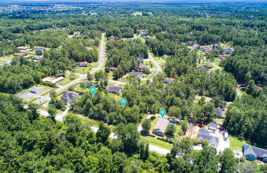 Aerial of Home and Next Door Lots