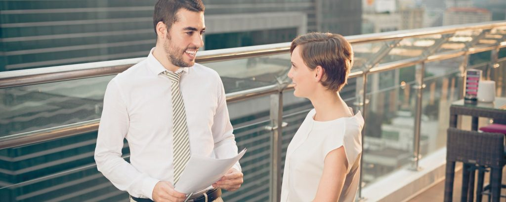 Two Realtors Discussing Plans