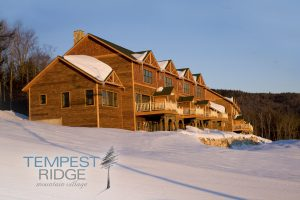 Tempest Ridge Townhomes with snow and logo