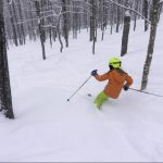 Girl skiing in the trees
