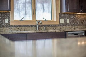 Kitchen with granite counter tops and tiled backsplash