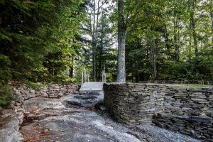 Foot bridge and stone wall