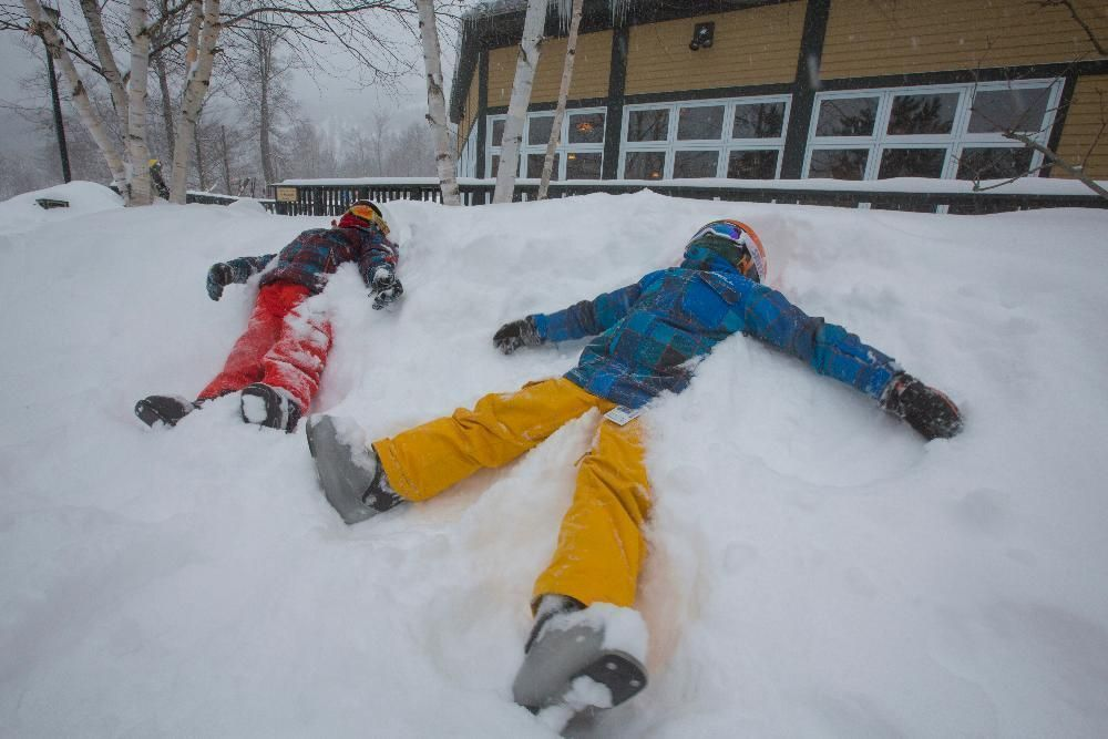 Kids laying in the snow