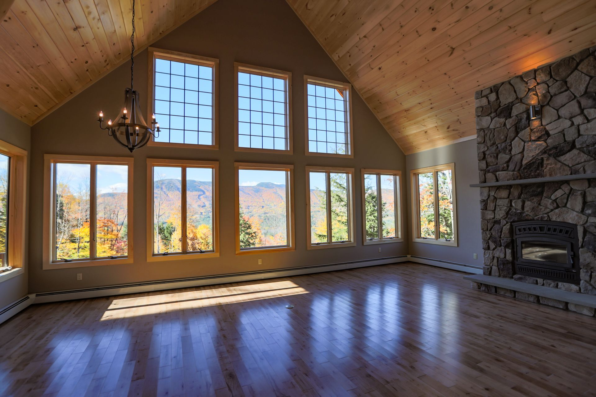 Living space with fireplace and mountain views