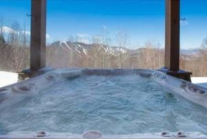 Outdoor hot tub with view of Sunday River