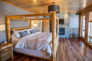 Timber bed frame in rustic bedroom