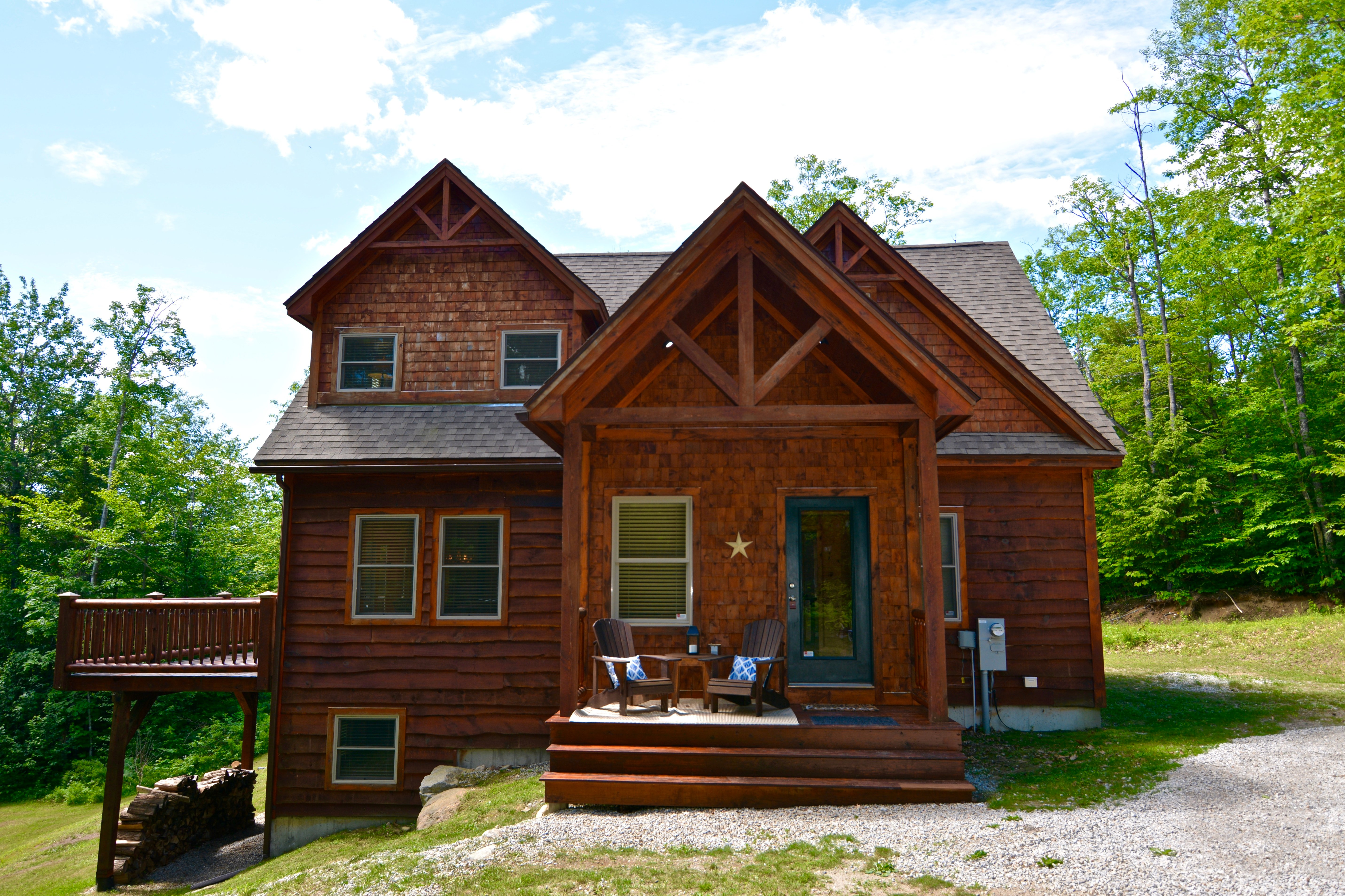 Home with live edge siding and cedar shingles