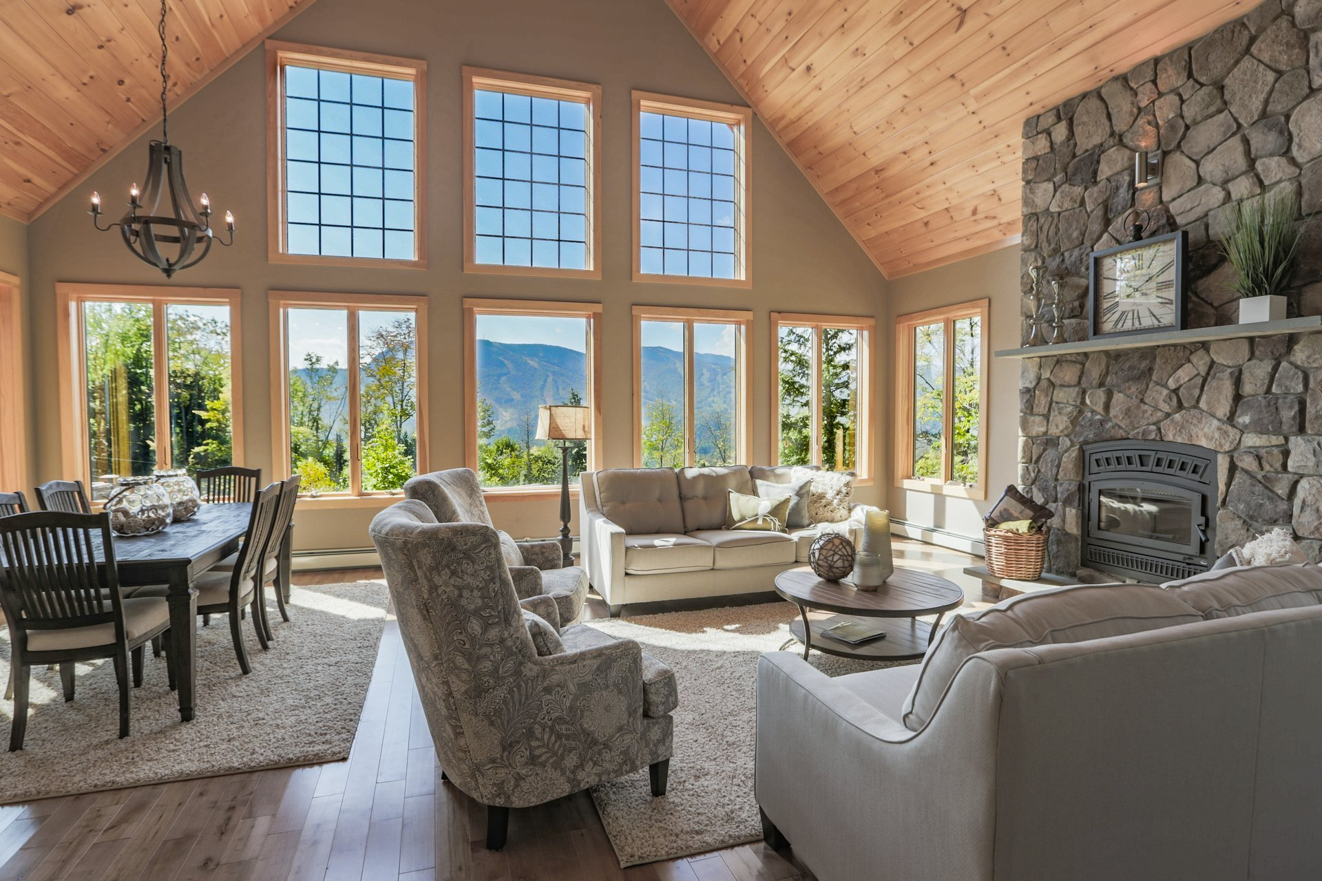 Open concept dining room and living area with stone hearth