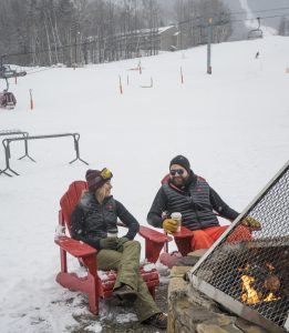 Man and woman enjoying apres-ski at Sunday River