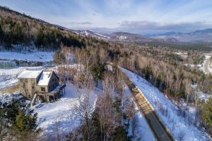 Home on Locke SUmmit with aerial view of road and Sunday River