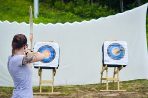 Girl taking archery course with Sunday River Outfitters