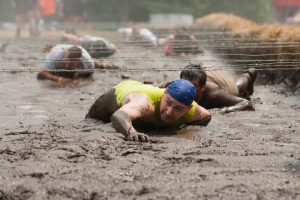 Competitor in mud during the Tough Mountain Challenge