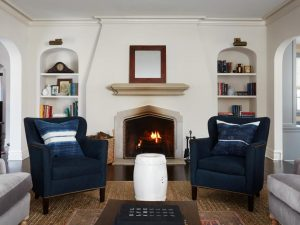 Living room with blue accent chairs